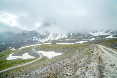 tien shan: Twisting road in mountains of Tien Shan, Kyrgyzstan Stock Photo
