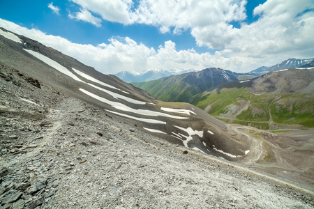 unsurfaced road: Hiking path in high mountains in tien Shan, Kyrgyzstan Stock Photo