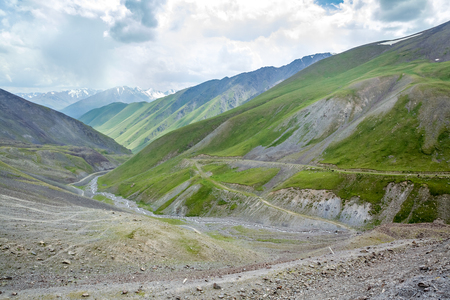 unsurfaced road: Serpentine mountain road. View from Kegety pass, Tien Shan, Kyrgyzstan Stock Photo