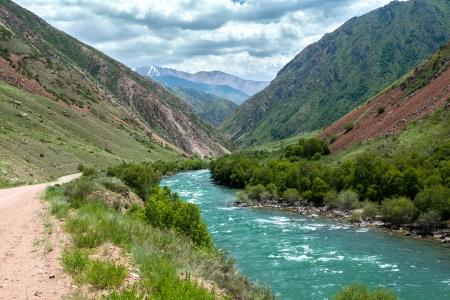 motton blue: Turquoise river Kekemeren in Tien Shan mountains, Kyrgyzstan Stock Photo