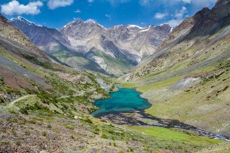 motton blue: Turquoise mountain lake in Tien Shan mountains