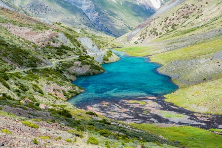 motton blue: Majestic mountain lake in Kyrgyzstan, Central Asia Stock Photo