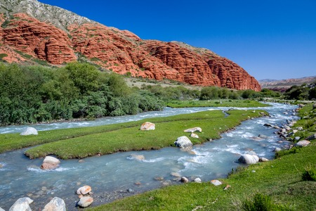 motton blue: Djuku river and red rock formations in Tien Shan mountains, Kyrgyzstan
