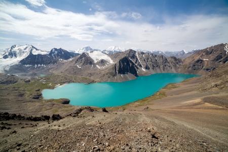 motton blue: View of alpine mountain lake Ala-Kul< Tien Shan, Kyrgyzstan Stock Photo