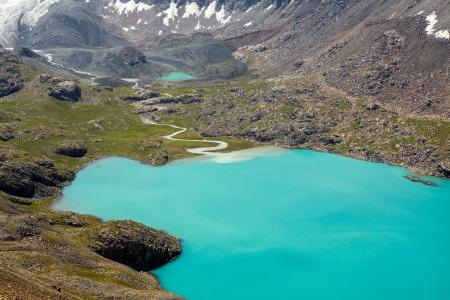motton blue: Majestic mountain lake Ala-Kul, Tien Shan mountains, Kyrgyzstan