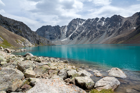 motton blue: Majestic lake Ala-Kul, Tien Shan mountains, Kyrgyzstan
