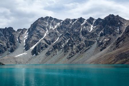 motton blue: Wonderful alpine lake Ala-Kul, Tien Shan, Kyrgyzstan