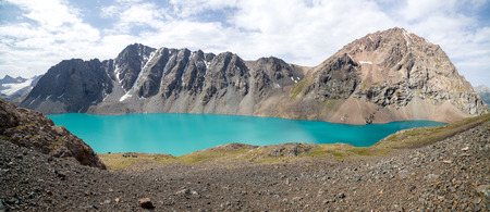 motton blue: Amazing turquoise mountain lake Ala-Kul, Tien Shan, Kyrgyzstan Stock Photo