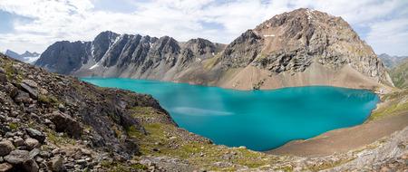motton blue: Panoramic view of Ala-Kul lake in Kyrgyzstan, Tien Shan mountains