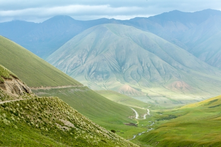 Scenic road in mountains of Tien Shan, Kyrgyzstan Фото со стока