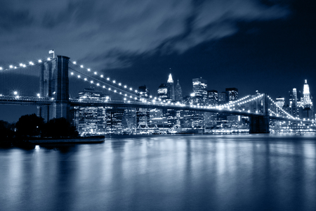 Brooklyn Bridge in cold blue tones at night. New York City