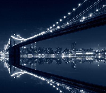 New York City, Brooklyn Bridge with reflections on water Фото со стока