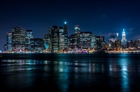 Manhattan at night, New York City. View from Brooklyn Фото со стока