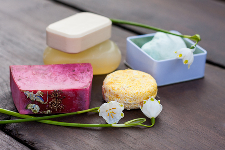 Zero waste, organic, plastic free options for your bathroom. Natural soap bars, bath bomb in a reusable tin container and an all in one shampoo/conditioner with spring flowers as decoration