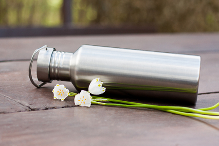 A look into zero waste lifestyle - everyday items. A durable stainless steel water bottle and a cute bouquet of flowers