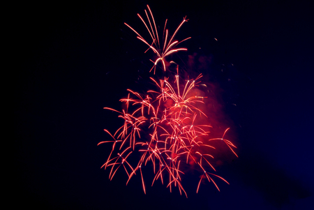 pyrotechnics: Night Red Fireworks. Pyrotechnics. Celebrate. Twilight Party Stock Photo