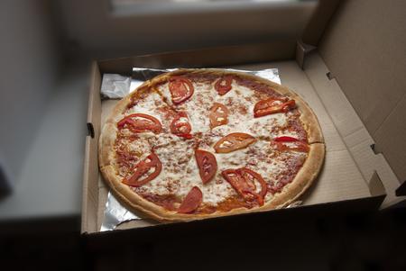 margherita: Delicious Italian Pizza Margherita with Tomatoes in Box Stock Photo