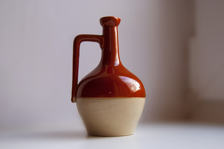 loamy: Ancient Wine Jug. Red and White Colors