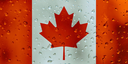 Flag of Canada on a water drops background. Canadian Flags waterdrop texture.