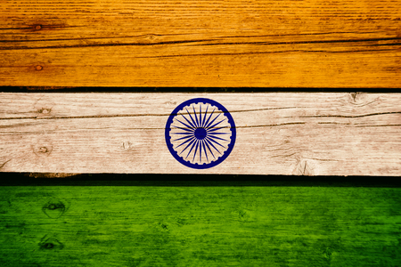 India National Flag on a wooden bavkground. Indian Flags wood texture. Imagens