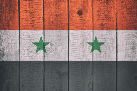Flag of Syria on a Wooden Background. Syrian National Flags on a wood texture Imagens