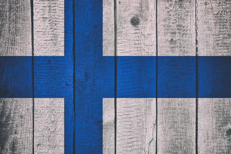 Flag of Finland on a Wooden Background. Finnish National Flags on a wood texture
