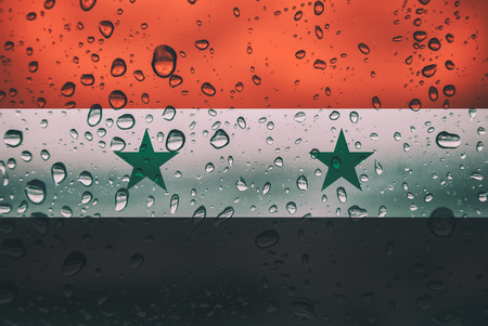 Flag of Syria on a water drops background. Syrian Flags waterdrop texture
