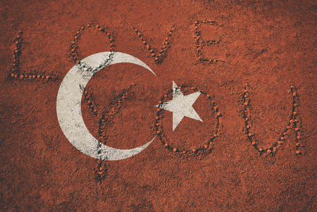 Turkey National Flag on a sand background with a LOVE YOU words.. Turkish Flags sandy texture