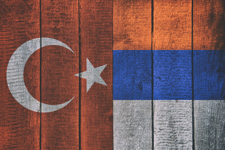Russian and Turkish National Flags on a Wooden Background. Russia and Turkey Flag Wood Texture.
