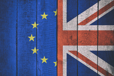 Flags of Great Britain and Europe on a wooden background. Brexit decision Imagens