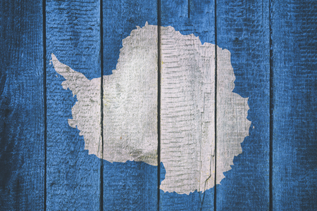 Flag of Antarctica on a Wooden Background. 写真素材