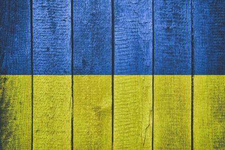 Ukraine National Flag on a wooden background. Ukrainian Flags wood texture.