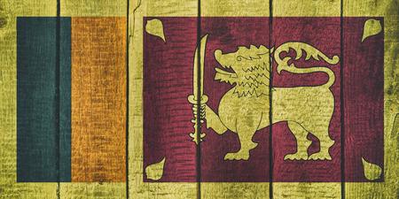 Sri Lanka National Flag on a wooden background Imagens
