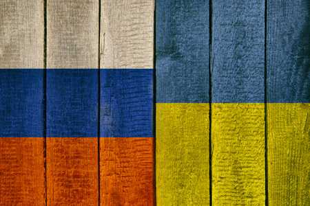 Ukraine and Russia National Flags on a wooden background. Ukrainian and Russian flag wood texture