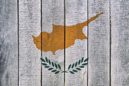 Old  wooden table texture background top view  with a National Flag of Cyprus. Cyprus Flags image.