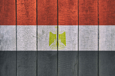 Old  wooden table texture background top view  with a National Flag of Egypt. Egyptian Flags image. Imagens