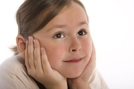 wistful: Young girl looking wistful with face in hands isolated against white background Stock Photo