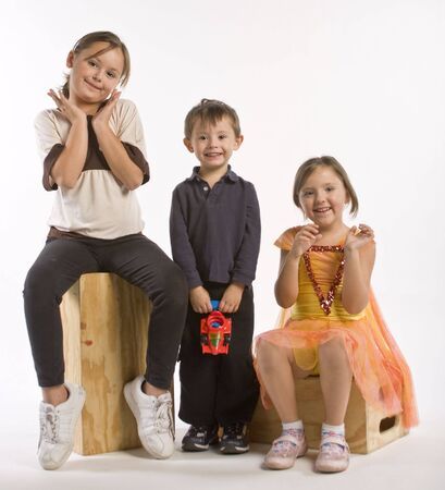 Two sisters and their brother acting silly Stock Photo - 5797585