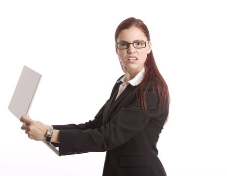 incensed: Woman in business attire angrily holding laptop computer