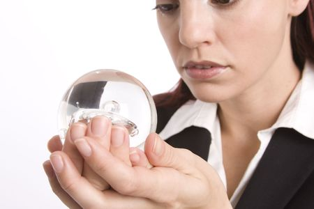 foreshadow: Closeup of a woman holding a crystal ball in her hand
