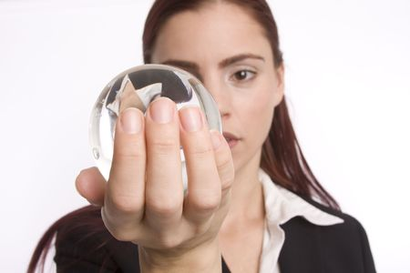 foreshadow: Woman in business attire holding crystal ball in her hand