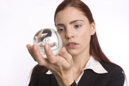 foreshadow: Businesswoman holding a crystal ball in her hand