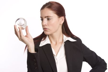 Young woman in business suit holding crystal ball in her hand Stock Photo