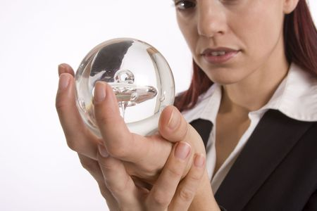 foreshadow: Closeup of a woman hands holding a crystal ball with face slightly out of focus Stock Photo