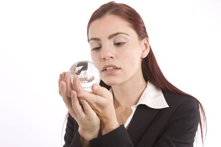 soothsayer: Mujer en traje de negocios sosteniendo una bola de cristal en sus manos Foto de archivo