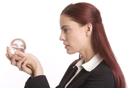 foreshadow: Woman in business suit holding crystal ball in her hands