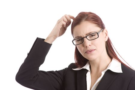 Woman in business suit scratching her head in wonderment