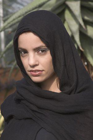 Beautiful woman with black head scarf on photo
