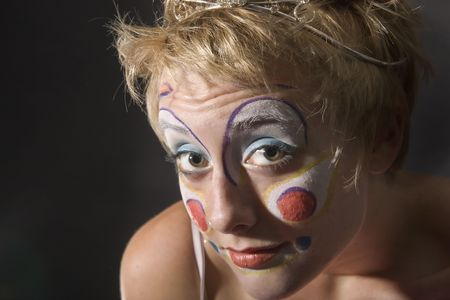 Closeup of the face of a woman clown