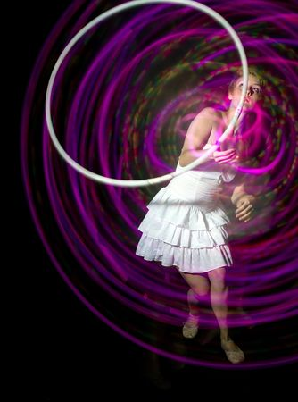 Young woman hula hooping
